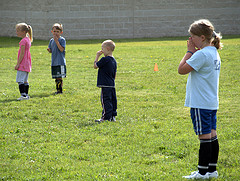 Kids doing soccer drills at practice